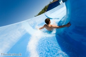 Couple have sex on top of water slide
