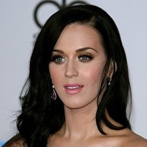 Katy Perry dons sexy stockings and mini-skirt