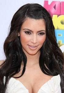 Kim Kardashian frolics in bikini on beach holiday