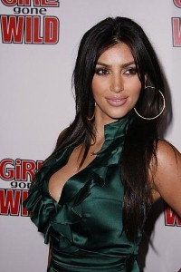 Kim Kardashian strips to underwear in photo shoot