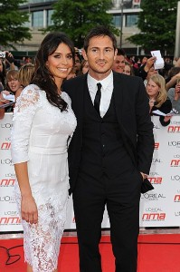 Lampard cuddles up with Christine Bleakley on holiday